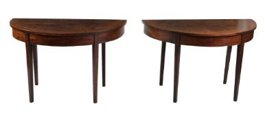 A pair of George III mahogany and string inlaid side tables