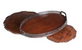 A group of three various mahogany trays