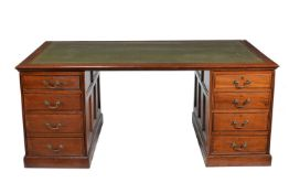 An Edwardian mahogany partners pedestal desk