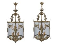 A pair of substantial gilt metal and glazed circular hall lanterns in Rococo taste
