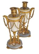 A pair of late Louis XVI white and dove grey marble and ormolu mounted candlesticks