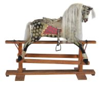 A painted wood and composition rocking horse
