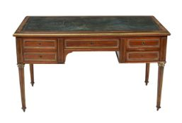 A French mahogany and gilt brass mounted writing table