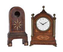 ϒ A patridgewood, satinwood, and inlaid mantel timepiece