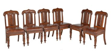 A harlequin set of ten Gothic Revival oak and upholstered dining chairs