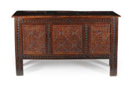 An oak triple panel chest