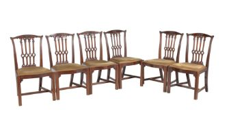 A set of six mahogany dining chairs in George III Gothic style