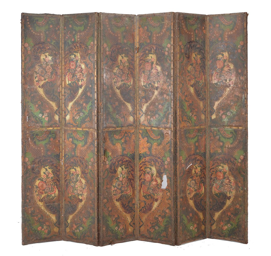 Lot 366 - An embossed and painted leather six-fold room screen