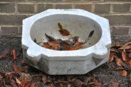 A marble wall basin