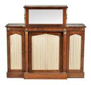 ϒ A Regency rosewood and gilt metal mounted breakfront side cabinet