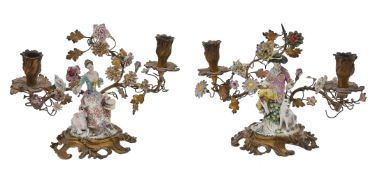 A pair of Continental porcelain mounted gilt-metal twin-light figural candelabra in Louis XV style
