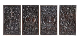 A set of four carved oak recessed relief panels