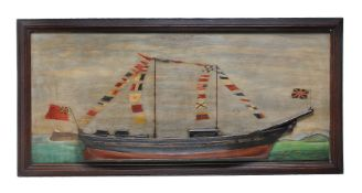 A carved and painted wood half hull picture of a two masted brig
