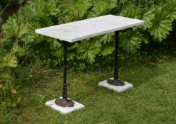 A black painted cast iron and striated white marble conservatory or garden table