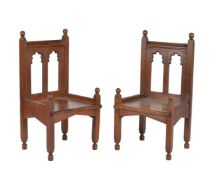 A pair of oak Gothic revival armchairs