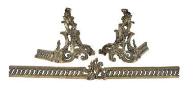 A French gilt metal extending fender in Louis XV taste