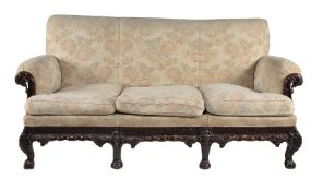 A carved mahogany and upholstered sofa