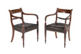 A pair of Regency mahogany armchairs