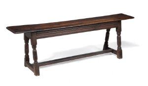 A Charles I oak long stool