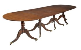A mahogany four pedestal dining table