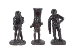 Three Continental, probably French, carved and stained wood models of peasants