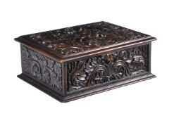 An Anglo-Indian carved and stained hardwood casket