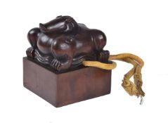 A Chinese carved wood seal