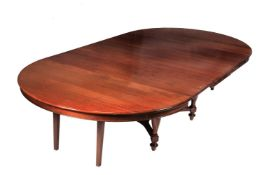 A French mahogany extending dining table