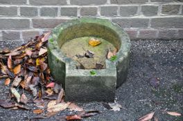 A limestone wall basin
