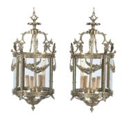 A pair of gilt metal and glazed circular hall lanterns in Rococo taste