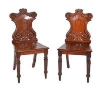 A pair of William IV mahogany hall chairs