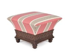 A George IV carved oak and upholstered ottoman footstool