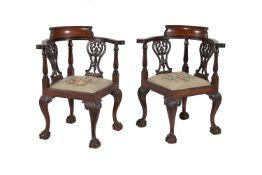 A pair of mahogany corner chairs