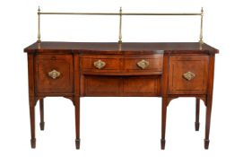 ϒ A George III mahogany and ebony strung sideboard