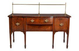ϒ A George III mahogany and ebony strung sideboard