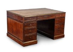 A mahogany and brass inlaid partners pedestal desk