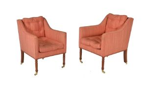 A pair of mahogany and upholstered armchairs