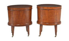 A matched pair of mahogany and tulipwood crossbanded oval cellarettes