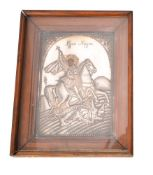An Egyptian Coptic icon of St George and the dragon with a silver coloured oklad