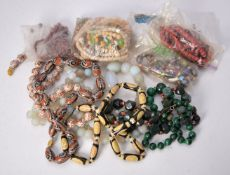 A group of bead necklaces