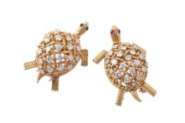 Two 1960s diamond turtle brooches by Cartier