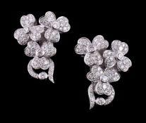 A pair of diamond floral spray earrings