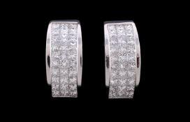 A pair of diamond half hoop earrings