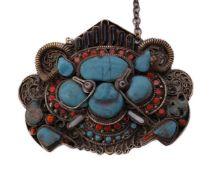 A Tibetan/Newari monster mask pendant