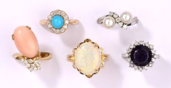 Fünf Ringe585- Gelb-/Weißgold, Brillanten, Perlen, Engelhautkoralle, Amethyst, Türkis und Opal.