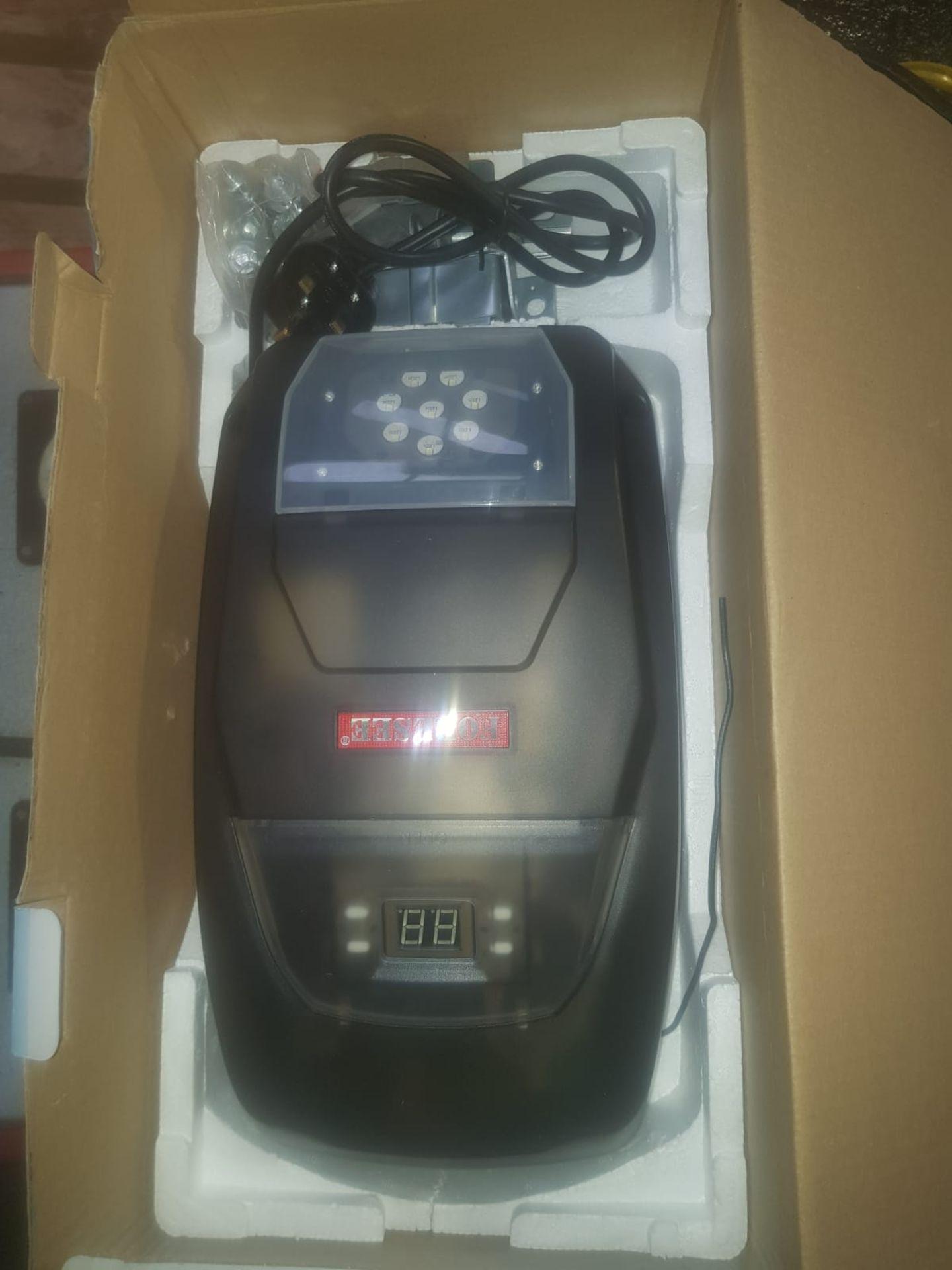 Lot 11 - NEW IN BOX ELECTRIC GARAGE DOOR