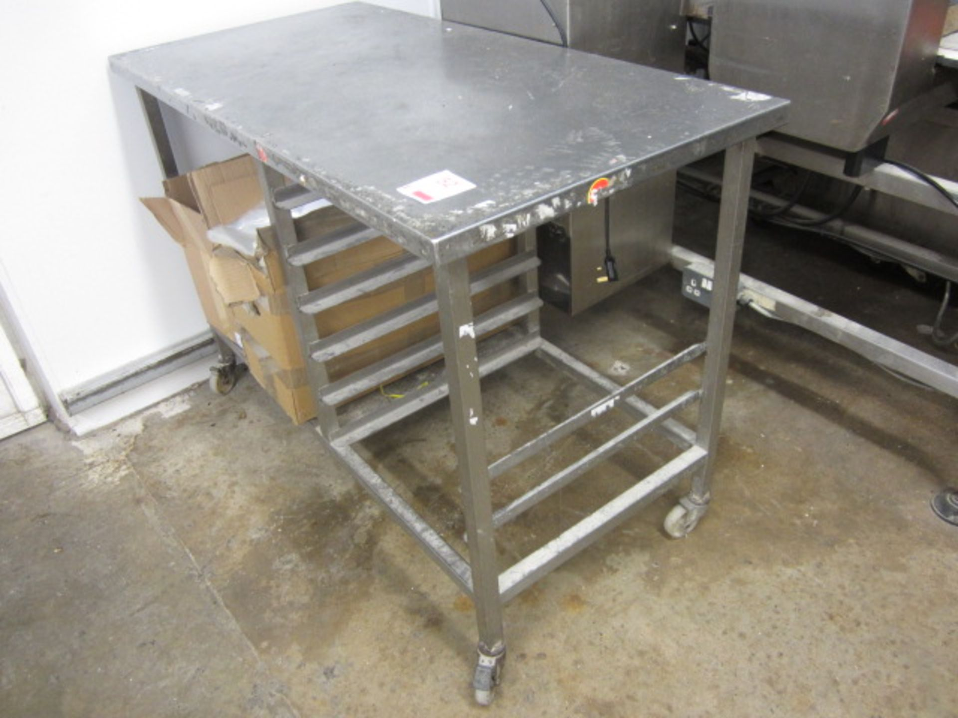 Lot 52 - Stainless steel mobile food preparation work surface with undercounter shelving rack. approx. 1200 x