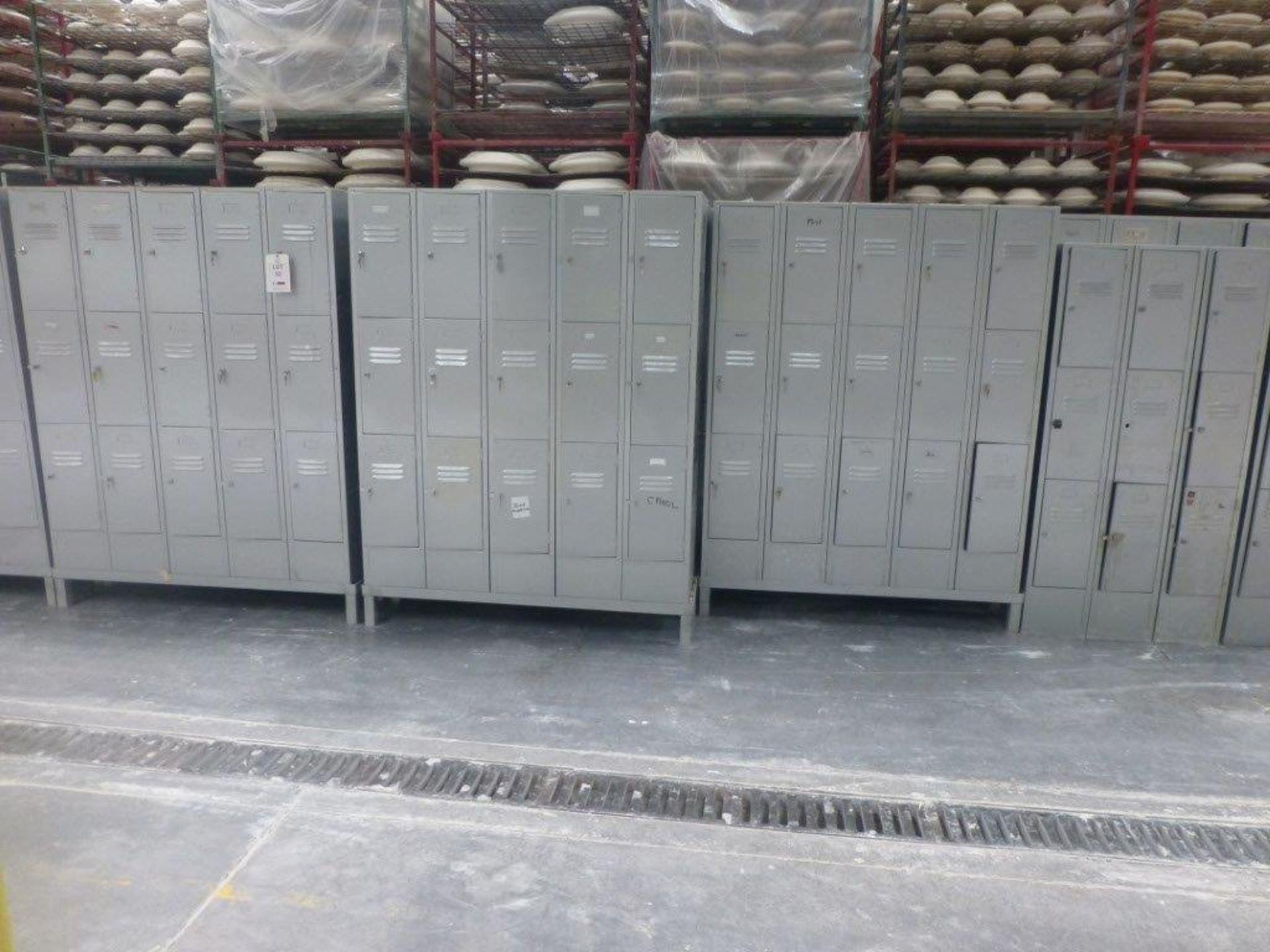 Lot 52 - 50 three compartment steel personnel locker units