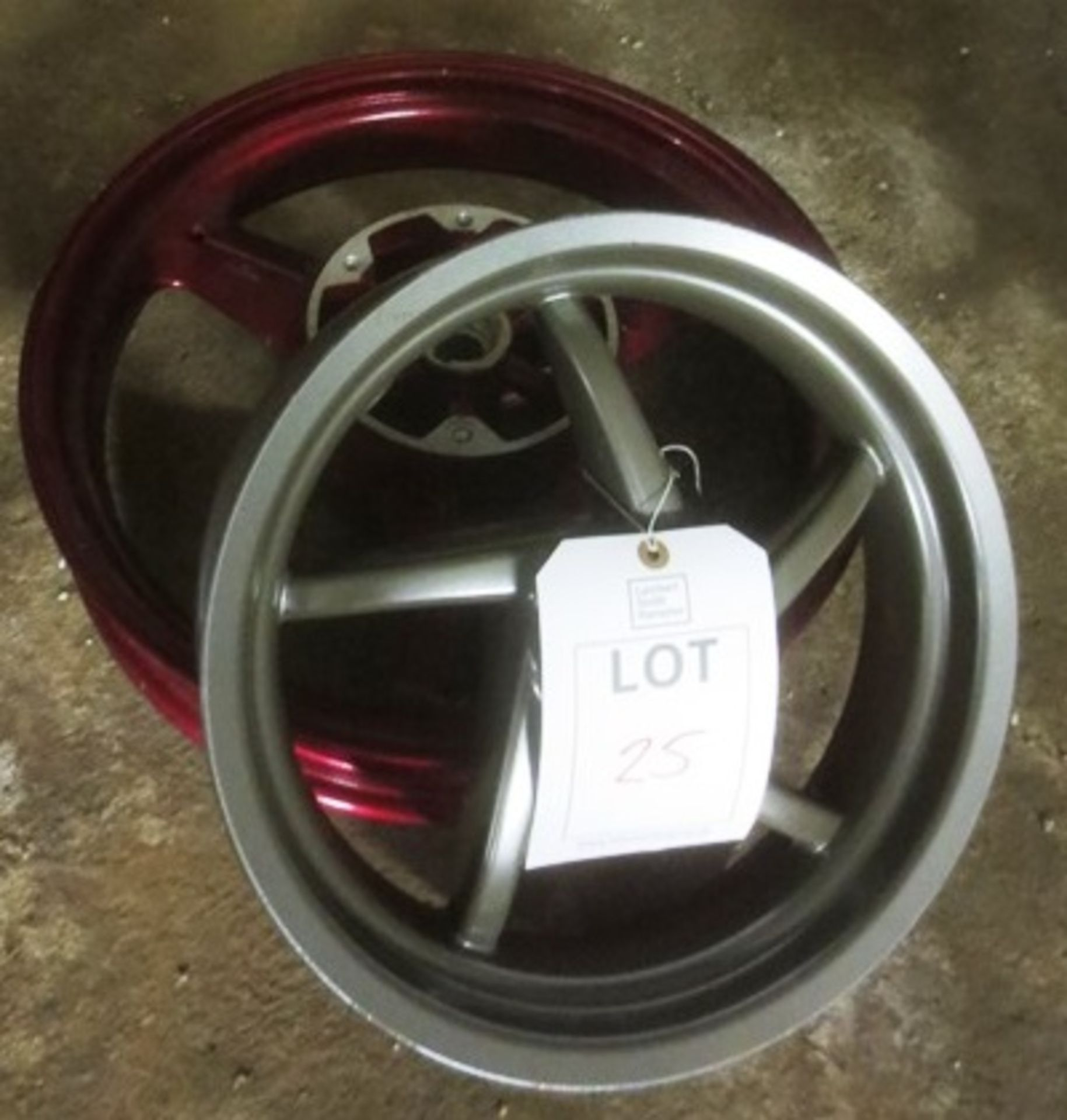 "Lot 25 - Two various alloy motorcycle wheels incl. dia 14"" and 18"""