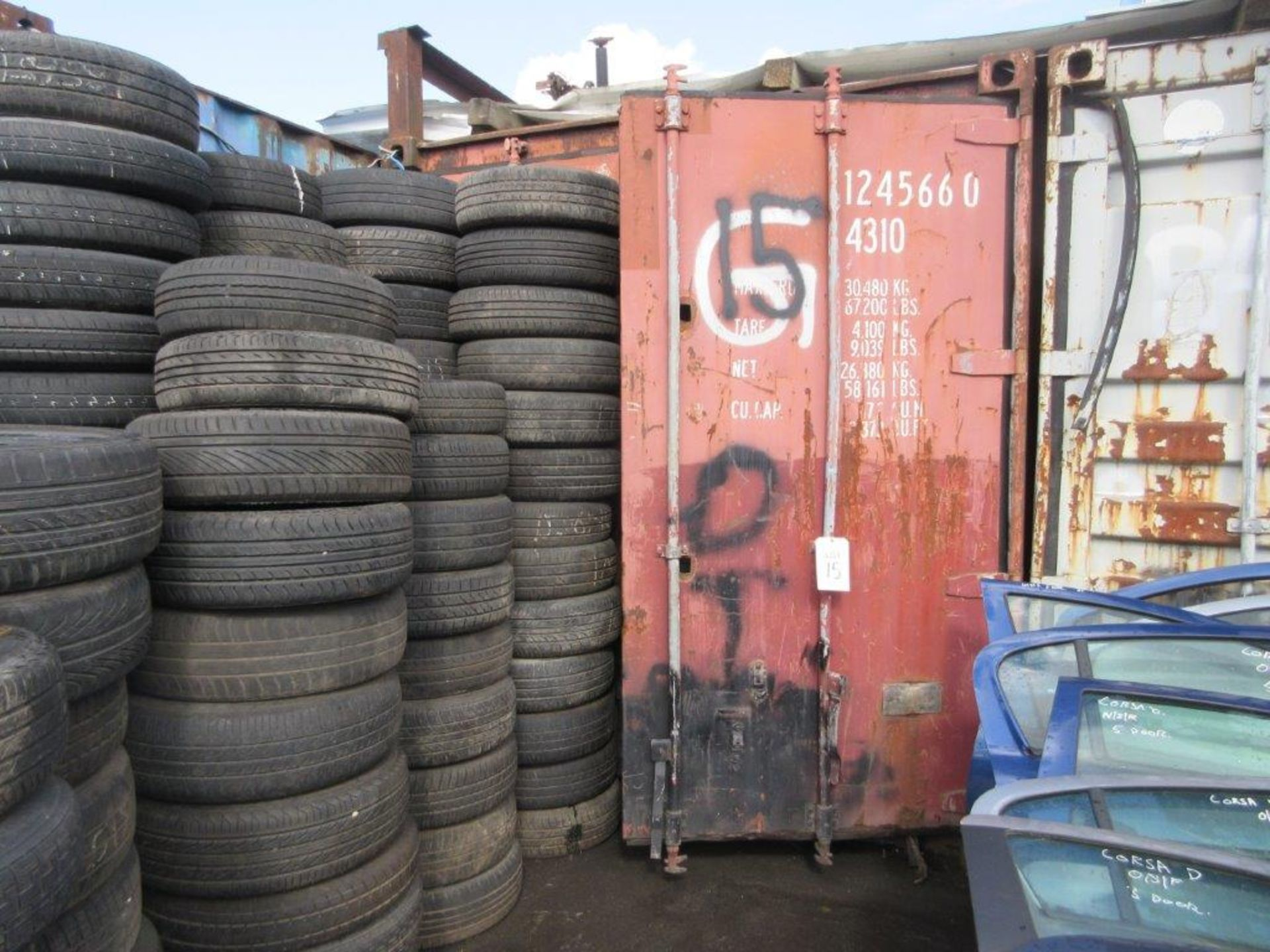 Lot 15 - Brown steel shipping container, 40 ft. x 8 ft. approx. plus rack and contents including steering